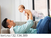 Купить «happy middle aged father with baby at home», фото № 32134389, снято 13 июня 2019 г. (c) Syda Productions / Фотобанк Лори