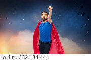 Купить «man in red superhero cape over night sky», фото № 32134441, снято 3 декабря 2016 г. (c) Syda Productions / Фотобанк Лори