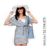 young woman in striped tunic and sun hat. Стоковое фото, фотограф Syda Productions / Фотобанк Лори
