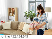 Купить «asian woman picking dirty laundry at home», фото № 32134545, снято 13 апреля 2019 г. (c) Syda Productions / Фотобанк Лори