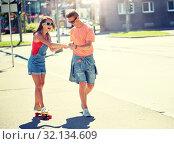 Купить «teenage couple riding skateboards on city street», фото № 32134609, снято 19 июля 2016 г. (c) Syda Productions / Фотобанк Лори
