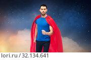 Купить «man in red superhero cape over night sky», фото № 32134641, снято 3 декабря 2016 г. (c) Syda Productions / Фотобанк Лори