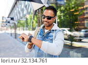 Купить «indian man with smart watch and backpack in city», фото № 32134761, снято 22 июня 2019 г. (c) Syda Productions / Фотобанк Лори