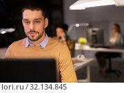Купить «man with computer working late at night office», фото № 32134845, снято 26 ноября 2017 г. (c) Syda Productions / Фотобанк Лори
