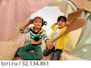 Купить «boys with pots playing in kids tent at home», фото № 32134861, снято 18 февраля 2018 г. (c) Syda Productions / Фотобанк Лори
