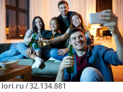 Купить «happy friends taking selfie by smartphone at home», фото № 32134881, снято 22 декабря 2018 г. (c) Syda Productions / Фотобанк Лори