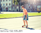 Купить «teenage boy on skateboard crossing city crosswalk», фото № 32135201, снято 19 июля 2016 г. (c) Syda Productions / Фотобанк Лори