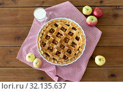 Купить «apple pie in baking mold on wooden table», фото № 32135637, снято 23 августа 2018 г. (c) Syda Productions / Фотобанк Лори