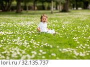 Купить «happy little baby girl at park in summer», фото № 32135737, снято 28 июля 2017 г. (c) Syda Productions / Фотобанк Лори