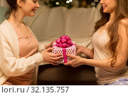 Купить «happy female friends with christmas gift at home», фото № 32135757, снято 21 января 2018 г. (c) Syda Productions / Фотобанк Лори