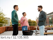happy friends having bbq party on rooftop. Стоковое фото, фотограф Syda Productions / Фотобанк Лори
