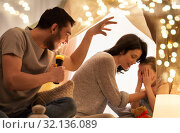 Купить «father telling scary stories to his daughter», фото № 32136089, снято 27 января 2018 г. (c) Syda Productions / Фотобанк Лори