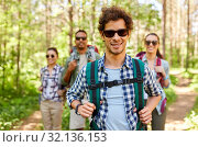 friends with backpacks on hike in forest. Стоковое фото, фотограф Syda Productions / Фотобанк Лори