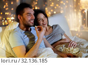 Купить «couple with popcorn watching tv at night at home», фото № 32136185, снято 27 января 2018 г. (c) Syda Productions / Фотобанк Лори