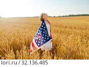 Купить «happy girl in american flag on cereal field», фото № 32136485, снято 26 июля 2019 г. (c) Syda Productions / Фотобанк Лори