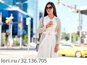 Купить «woman with takeaway coffee cup in city», фото № 32136705, снято 13 июля 2019 г. (c) Syda Productions / Фотобанк Лори
