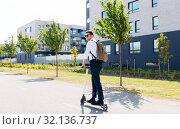 Купить «businessman with backpack riding electric scooter», фото № 32136737, снято 1 августа 2019 г. (c) Syda Productions / Фотобанк Лори