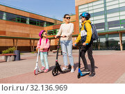 Купить «happy school children with mother riding scooters», фото № 32136969, снято 4 августа 2019 г. (c) Syda Productions / Фотобанк Лори