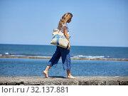 Купить «Woman by the sea, Route de La Corniche, Cantabrian Sea Coast, Hendaye, Aquitaine, Basque Country, France», фото № 32137881, снято 6 июня 2019 г. (c) age Fotostock / Фотобанк Лори