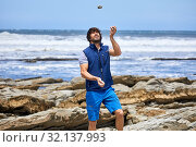 Купить «Man juggling with stones, by the sea, Route de La Corniche, Cantabrian Sea Coast, Hendaye, Aquitaine, Basque Country, France», фото № 32137993, снято 7 июня 2019 г. (c) age Fotostock / Фотобанк Лори