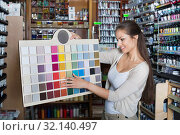 Купить «Portrait of young woman holding color sample palette», фото № 32140497, снято 24 февраля 2020 г. (c) Яков Филимонов / Фотобанк Лори