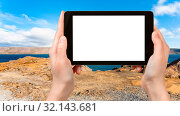 Купить «Travel concept - tourist photographs Kleifarvatn lake at Southern Peninsula (Reykjanesskagi, Reykjanes) in Iceland in autumn on tablet with cut out screen for advertising logo», фото № 32143681, снято 15 ноября 2019 г. (c) easy Fotostock / Фотобанк Лори