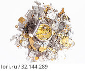 Купить «Watchmaker workshop - top view of open silver pocket watch on pile of old clock spare parts on white background», фото № 32144289, снято 29 января 2020 г. (c) easy Fotostock / Фотобанк Лори