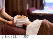 Купить «woman having face massage with towel at spa», фото № 32144557, снято 26 января 2017 г. (c) Syda Productions / Фотобанк Лори