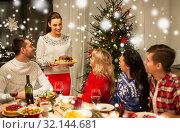 Купить «happy friends having christmas dinner at home», фото № 32144681, снято 17 декабря 2017 г. (c) Syda Productions / Фотобанк Лори