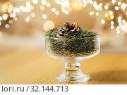 Купить «christmas fir decoration with cone in dessert bowl», фото № 32144713, снято 15 ноября 2017 г. (c) Syda Productions / Фотобанк Лори