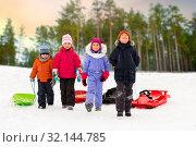 Купить «happy little kids with sleds in winter», фото № 32144785, снято 10 февраля 2018 г. (c) Syda Productions / Фотобанк Лори