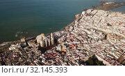Купить «Picturesque aerial view of Spanish port city of Cadiz with medieval Cathedral in sunny spring day», видеоролик № 32145393, снято 19 апреля 2019 г. (c) Яков Филимонов / Фотобанк Лори