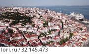 Купить «Picturesque aerial view of historical areas of Lisbon on bank of Tagus river overlooking medieval Roman Catholic Cathedral, Portugal», видеоролик № 32145473, снято 20 апреля 2019 г. (c) Яков Филимонов / Фотобанк Лори