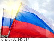 Russian national flags waving in the wind. Стоковое фото, фотограф FotograFF / Фотобанк Лори