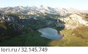 Купить «Aerial view of Picturesque summer landscape of highland Lakes of Covadonga within Picos de Europa National Park», видеоролик № 32145749, снято 15 июля 2019 г. (c) Яков Филимонов / Фотобанк Лори