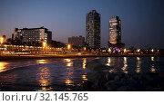 Купить «Night view of skyscrapers from port - center of nightlife at Barcelona. Catalonia, Spain», видеоролик № 32145765, снято 26 апреля 2019 г. (c) Яков Филимонов / Фотобанк Лори