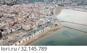 Купить «View from drone of famous tourist town of Roses on Catalan coast of Gulf of Roses, Costa Brava, Spain», видеоролик № 32145789, снято 10 февраля 2019 г. (c) Яков Филимонов / Фотобанк Лори