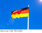 Flag of Germany flying in the wind against the sky. Стоковое фото, фотограф FotograFF / Фотобанк Лори