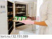 Купить «Antibacterial cabinet, beautician cleans tools», фото № 32151089, снято 13 марта 2019 г. (c) Tryapitsyn Sergiy / Фотобанк Лори
