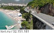 Купить «Budva, Montenegro - June 12.2019. The mountain road along the coast», видеоролик № 32151181, снято 17 октября 2019 г. (c) Володина Ольга / Фотобанк Лори