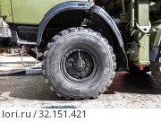 Купить «Kamaz truck wheel with Kama tire», фото № 32151421, снято 4 мая 2019 г. (c) FotograFF / Фотобанк Лори