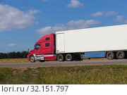 Купить «Large semi-trailer moves on a country road», фото № 32151797, снято 28 августа 2018 г. (c) Юрий Бизгаймер / Фотобанк Лори