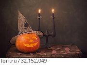Купить «Halloween pumpkin on dark background», фото № 32152049, снято 5 сентября 2019 г. (c) Майя Крученкова / Фотобанк Лори