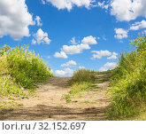 Купить «Landscape with green grass, road and clouds», фото № 32152697, снято 12 июля 2015 г. (c) Юрий Бизгаймер / Фотобанк Лори