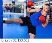 Купить «Potrait of man boxer who is training in gym.», фото № 32153005, снято 21 августа 2017 г. (c) Яков Филимонов / Фотобанк Лори