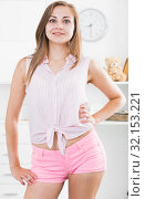 Купить «Girl in pink tight shorts at room», фото № 32153221, снято 24 июня 2017 г. (c) Яков Филимонов / Фотобанк Лори