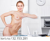 Young nude woman standing near the table and posing in the office. Стоковое фото, фотограф Яков Филимонов / Фотобанк Лори