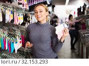 Купить «Woman shopping socks in leg-wear», фото № 32153293, снято 2 апреля 2020 г. (c) Яков Филимонов / Фотобанк Лори