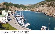 Sevastopol, Crimea - July 3. 2019. The Balaklava Bay from top in summer. Редакционное видео, видеограф Володина Ольга / Фотобанк Лори