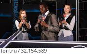 Купить «African male and fine women holding laser guns», фото № 32154589, снято 4 апреля 2019 г. (c) Яков Филимонов / Фотобанк Лори
